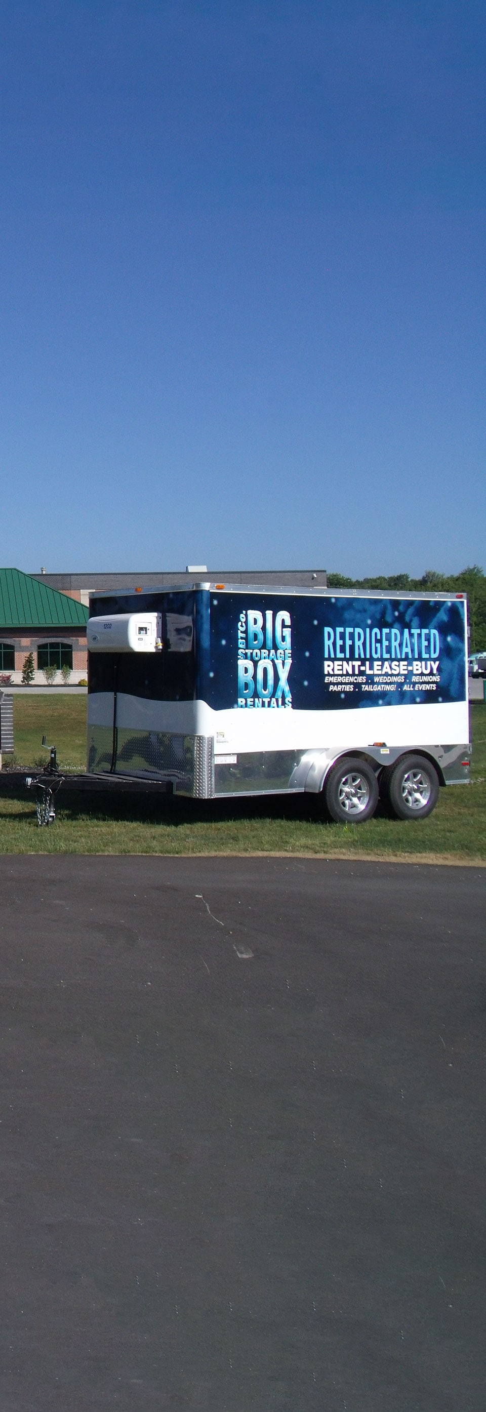 Portable refrigerated storage parked at an outdoor location.